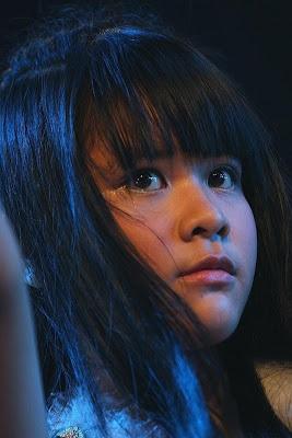 Delima foto premium content JKT48 clock