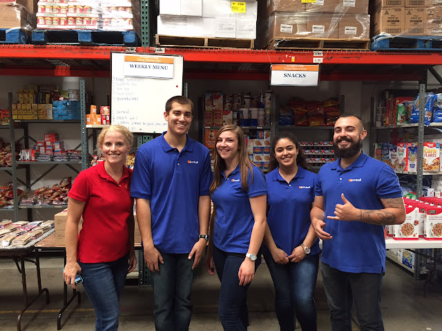 eGumball, Inc. employees participate in warehouse work for Giving Children Hope.