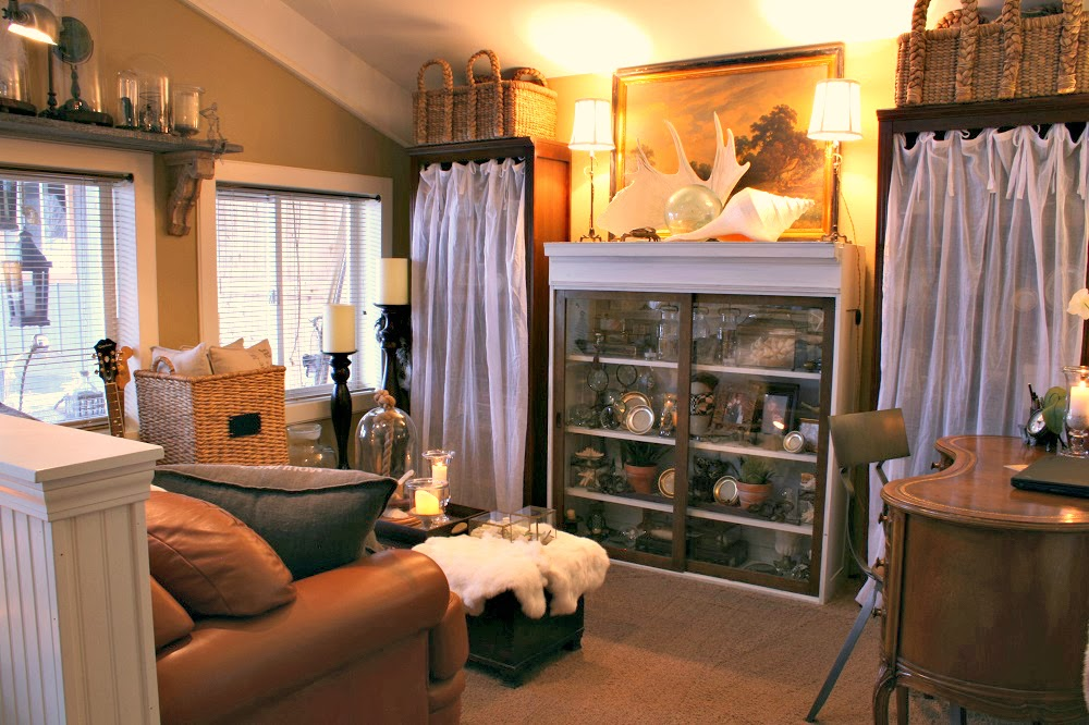 antler on a mantle, haberdashery lamps, beachcomber, glass float