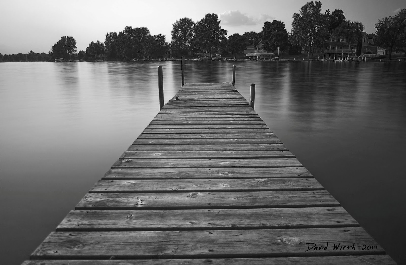 black and white dock, lake, cottage