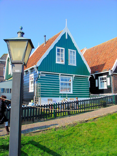 The green and black clapboard siding decorates most of the shops and homes in Marken.