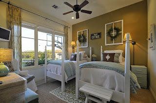 the guest bedroom has double single beds and wide windows for natural lights