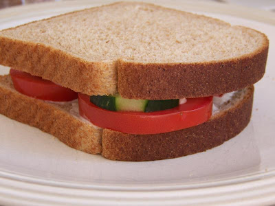 tomato and cucumber sandwich with garlic chive spread