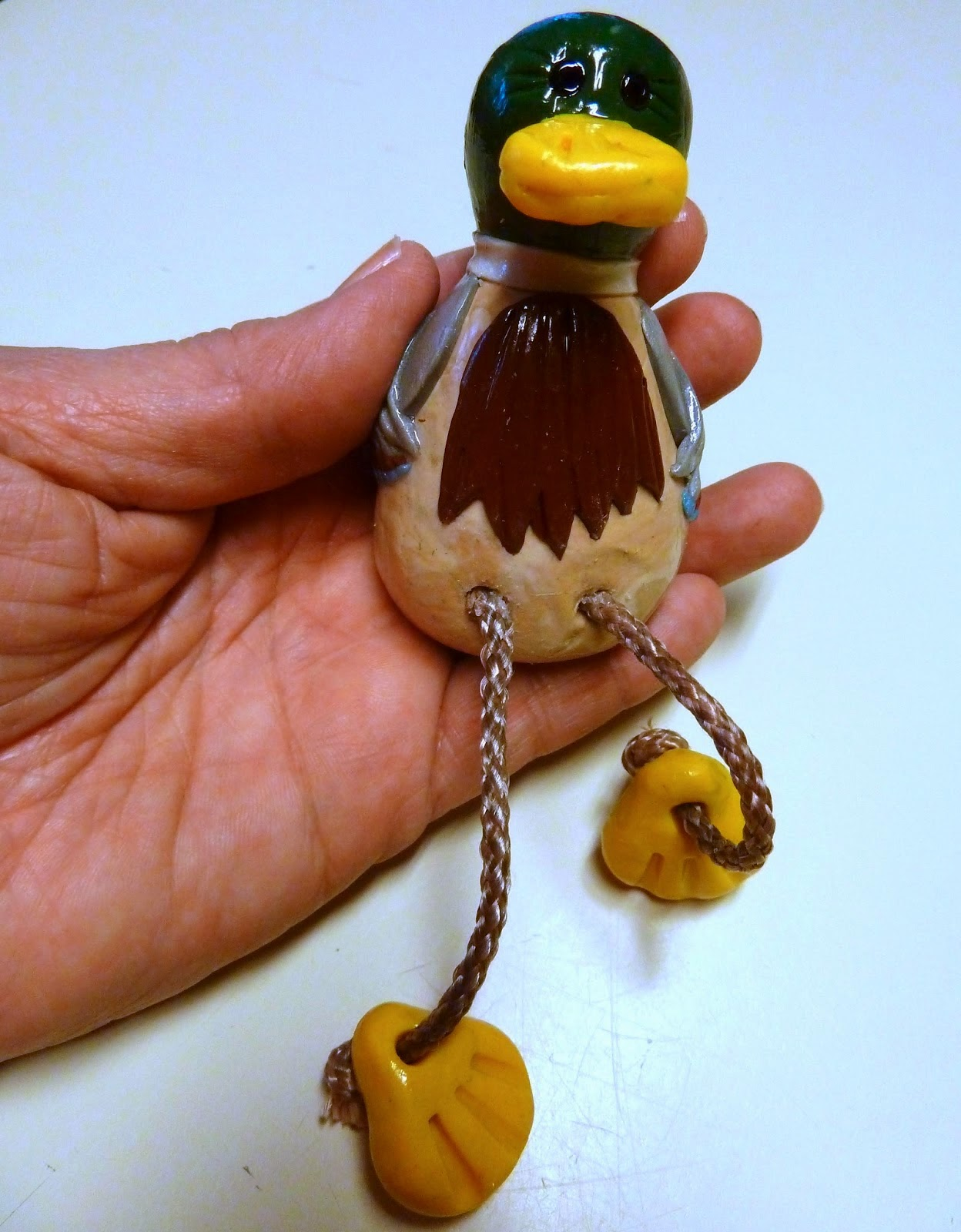 http://www.makeiteasycrafts.com/2014/03/sculpey-oven-baked-clay-sitting-duck.html