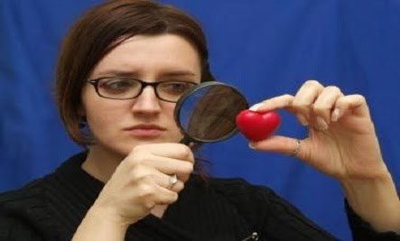 How Do You Find Love? 10 Tips - magnifying glass magnifier looking for woman hold heart