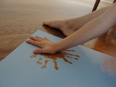 child's handprint painting the sun
