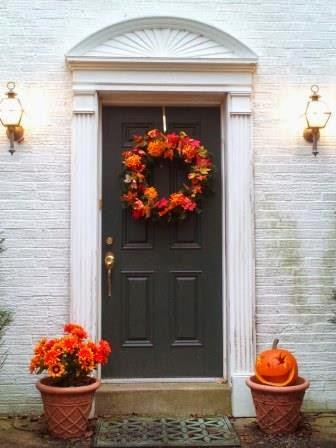 Front door decorated in Fall and Halloween theme