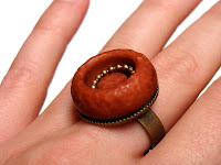 pumpkin and gold colored adjustable button ring