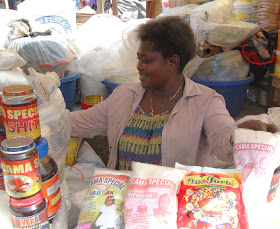 Helena Akua Afriyie sells a variety of complementary foods and flours at Kejeita Central Market in Kumasi, Ghana