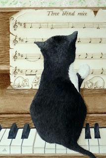 kitty at the piano