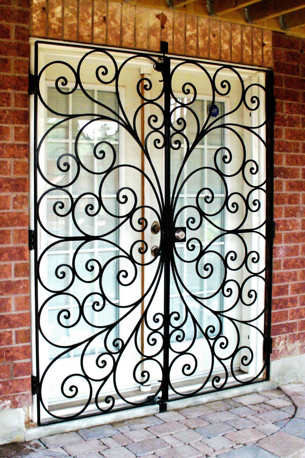 Wrought iron from julian wrought iron security doors for Wrought iron security doors