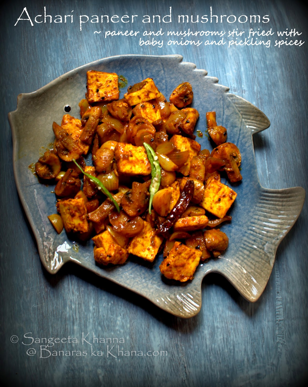 achari paneer and mushrooms   paneer and mushrooms stir fried with baby onions in indian pickling spices