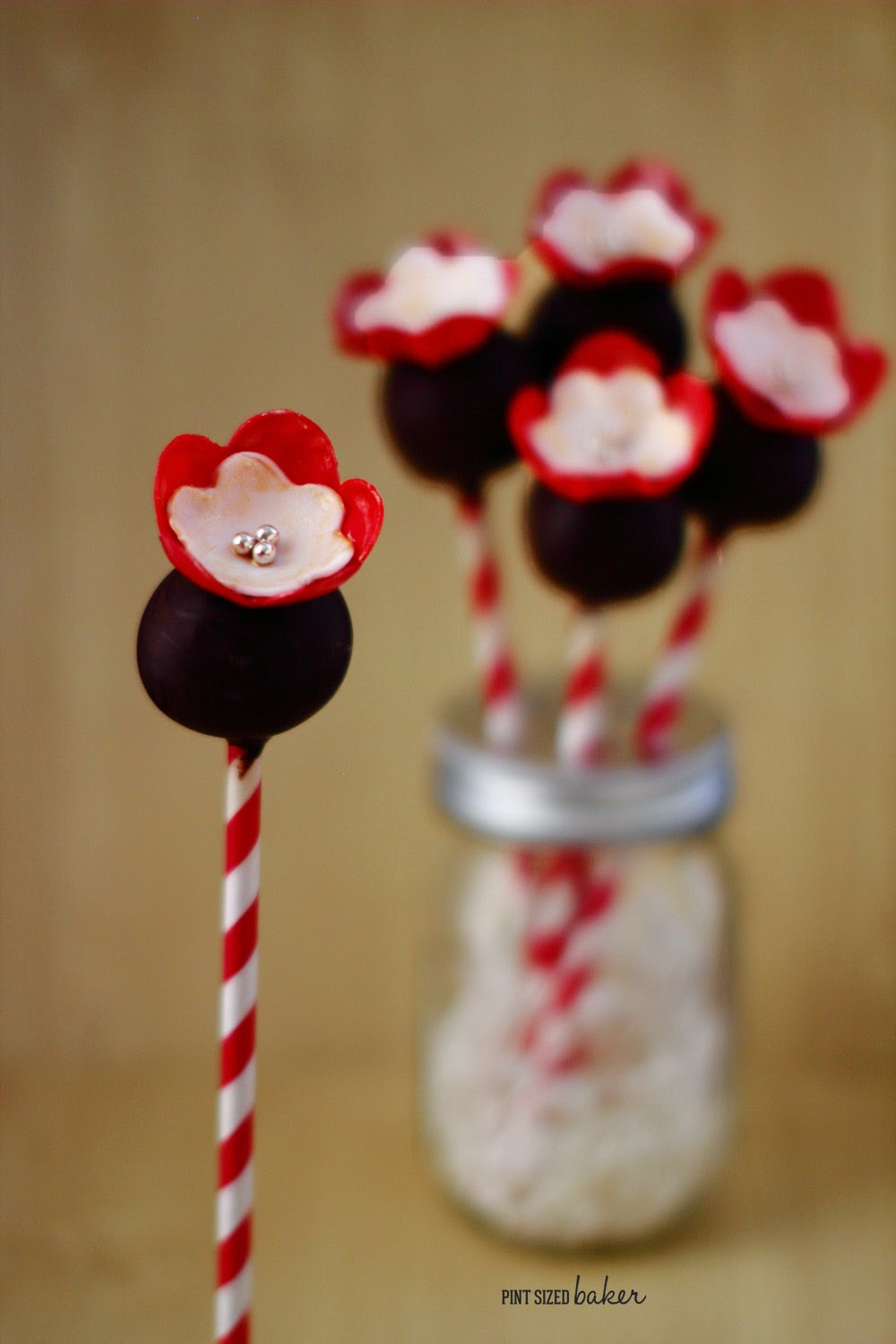 Perfect Fondant Flowers are easy to make. They make the most basic cake pops so much fancier!