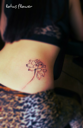 A drawing style lotus flower tattoo on the hip