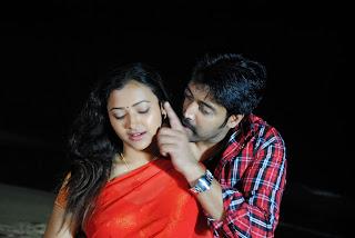 Swetha Basu Prasad Romances hero in Red Spicy Saree for movie Yuganiki Oka Premikudu