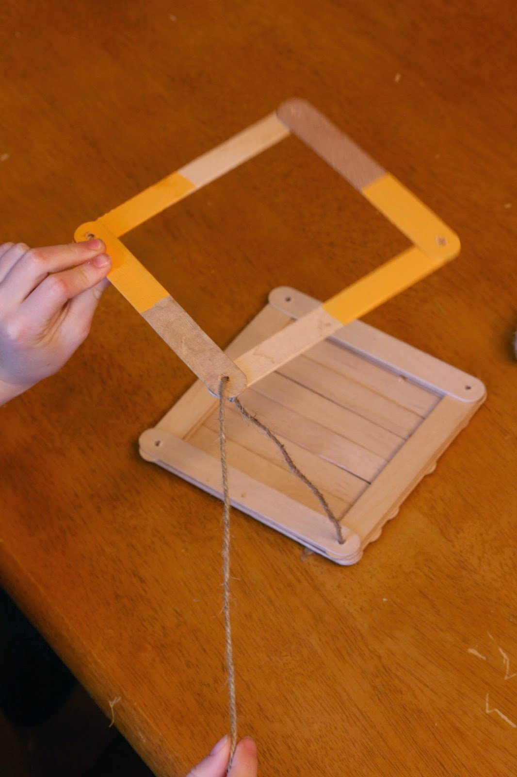 how to make a bird feeder with popsicle sticks