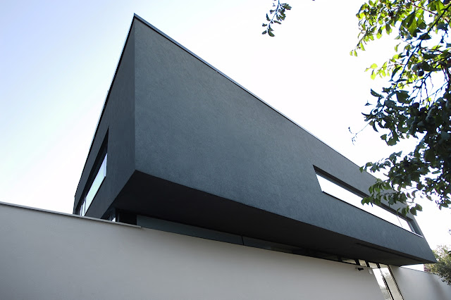 Black upper floor facade
