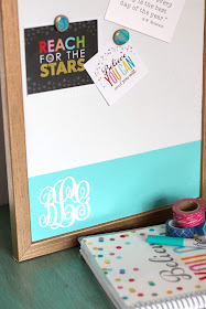 Makeover a plain memo board with spray paint and a vinyl monogram used as a reverse stencil. pitterandglink.com #monogram #Silhouette
