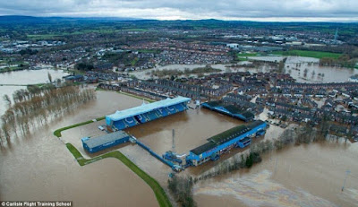 Flooding Norway - UK Battered with Storms 2F1D88FF00000578-3348001-Carlisle_United_Football_Club_s_stadium_Brunton_Park_remains_und-a-9_1449464024631
