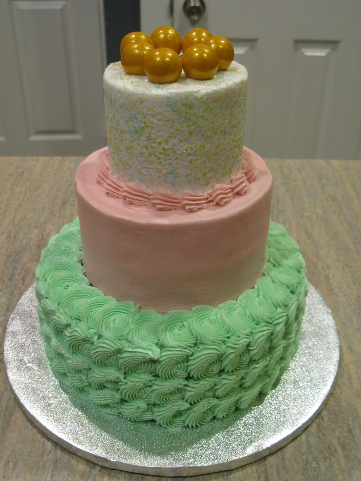 A Counselors Confections Pink Mint and Gold Birthday Cake