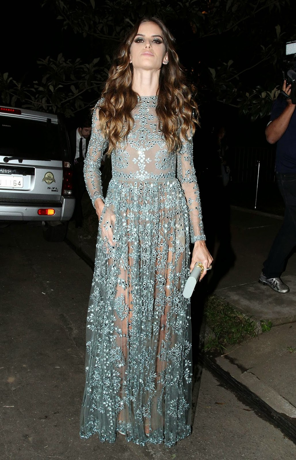 Izabel Goulart in a sheer embellished dress at the 5th Annual amfAR Inspiration Gala in Sao Paulo