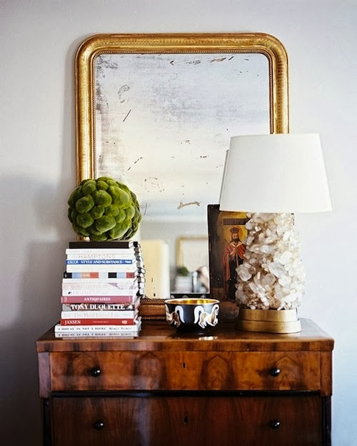 vignette styling chest table oversized gold mirror and accessories