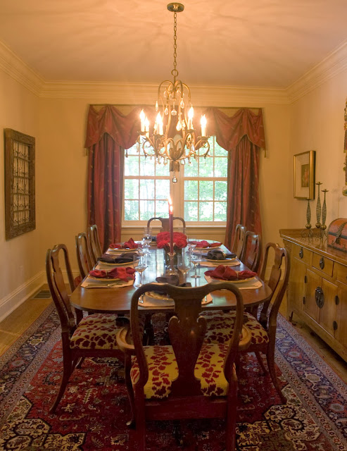 elegant dining room design with classic chairs and large table set on a beautiful patterned carpet