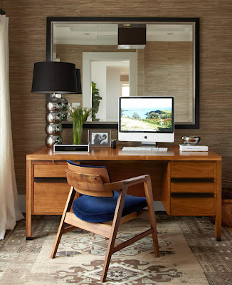 the work space provides a room for working as well as big mirror in its backdrop to open up more space