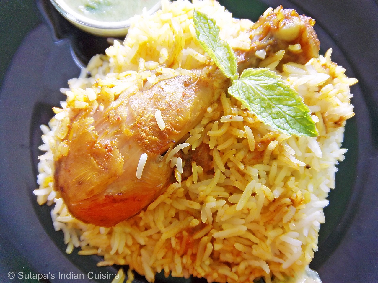 shahi chicken biriyani with burani raita n cashew ginger salad