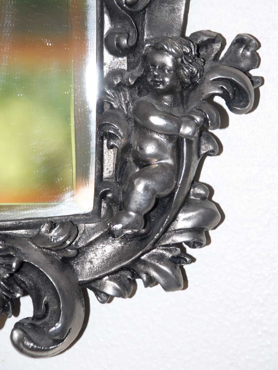 metal mirror with cherubs