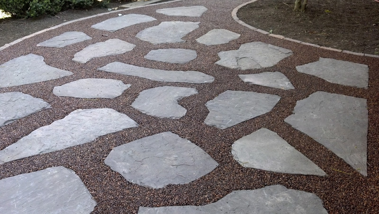 ... Caramel And Coffee Pebbles Mixed To Match The Color Of The Existing  Brick On The House. The Split Face Edger Was Set In Concrete Producing A  Durable ...