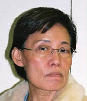 Picture of Mi Yong Kim, a middle-aged Korean woman with wire-rim glasses, short hair, and a sour facial expression