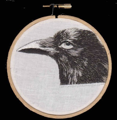 long and short stitch embroidered crow head