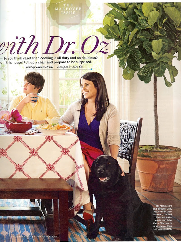 page from magazine, with Dr. Oz's slim and pretty wife and son sitting at table, black lab sitting on the floor next to wife, the dog is sitting awkwardly on one haunch, ears back and down, she is very heavy and uncomfortable looking