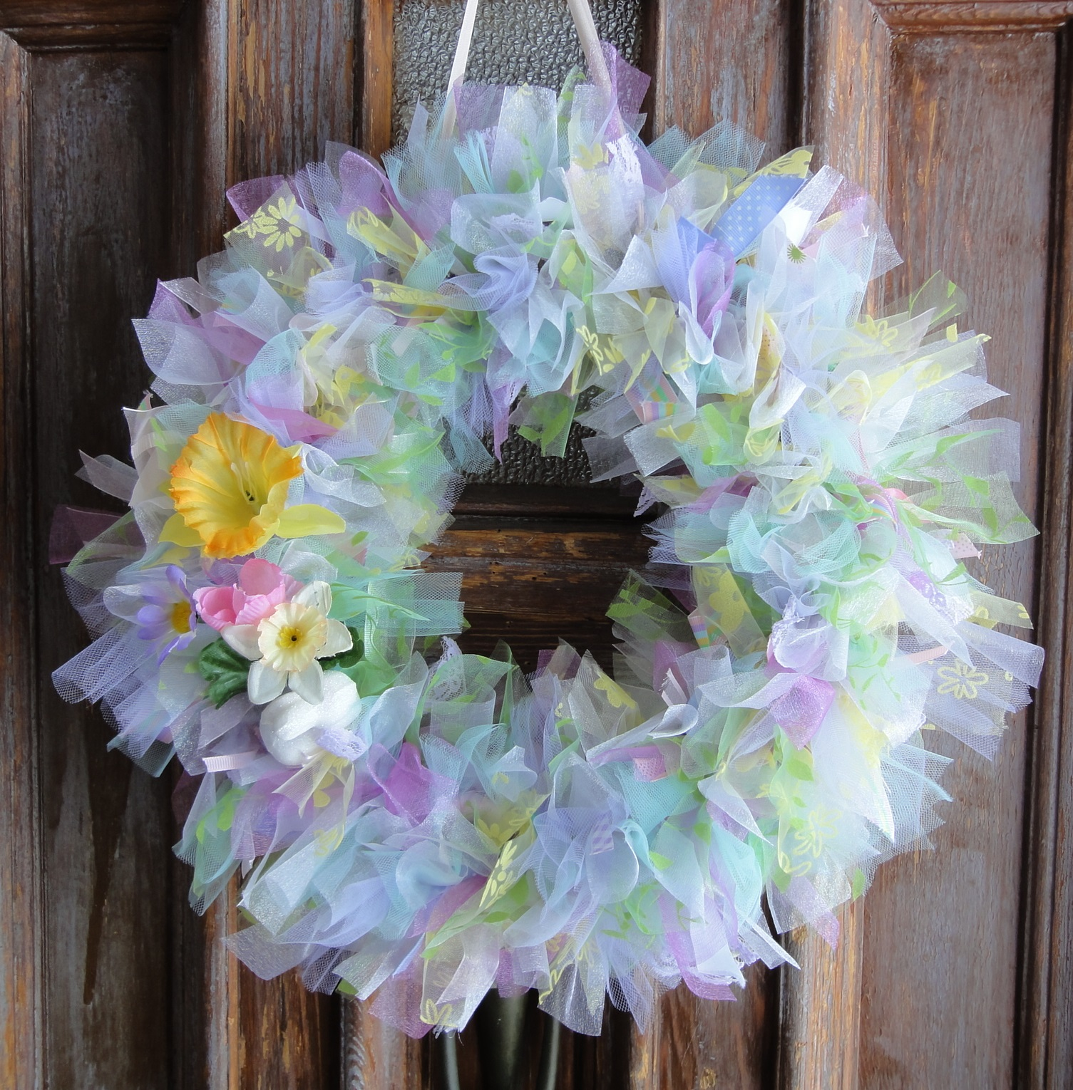 made a spring ribbon wreath for our front door