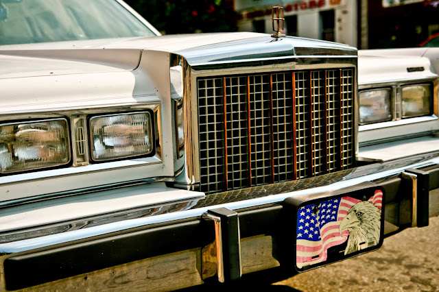 The front end of a car in Erie, Pennsylvania with a license plate that has an American flag and an eagle on it.