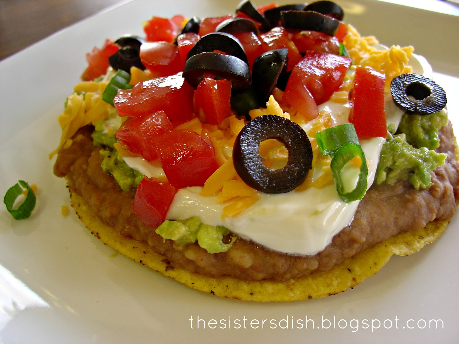 The Sisters Dish: 7 layer tostada