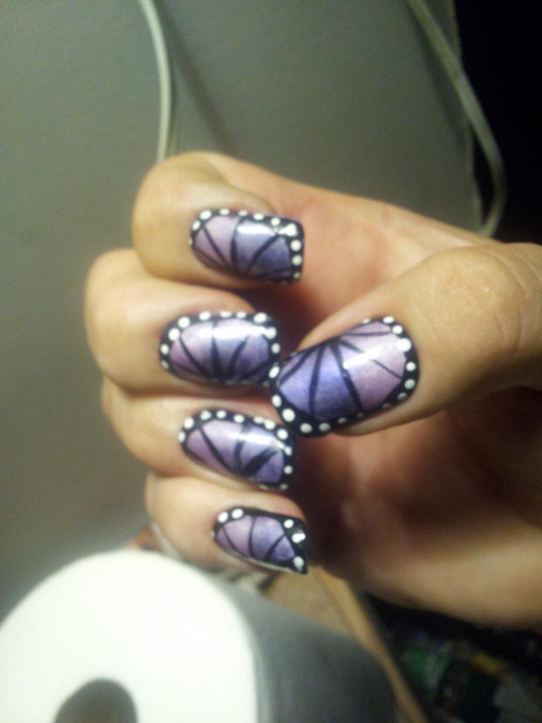 Men and nail polish: Butterflies and long nails.