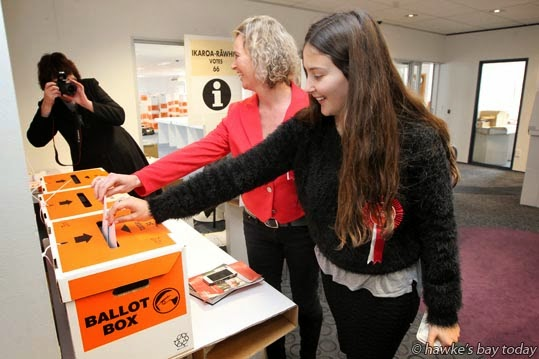 L-R: Diane Joyce, reporter, Hastings Mail; Anna Lorck, Labour candidate, Tukituki electorate; Tabitha Lorck, 18, Hastings, casting early votes at a polling booth at Heretaunga House, Warren St, Hastings, 18 days before the general election. photograph