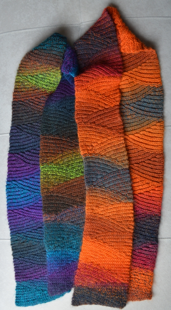 Crochet Stitches Slip Stitch : Two slip stitch scarves lying side-by-side; made from colour-changing ...