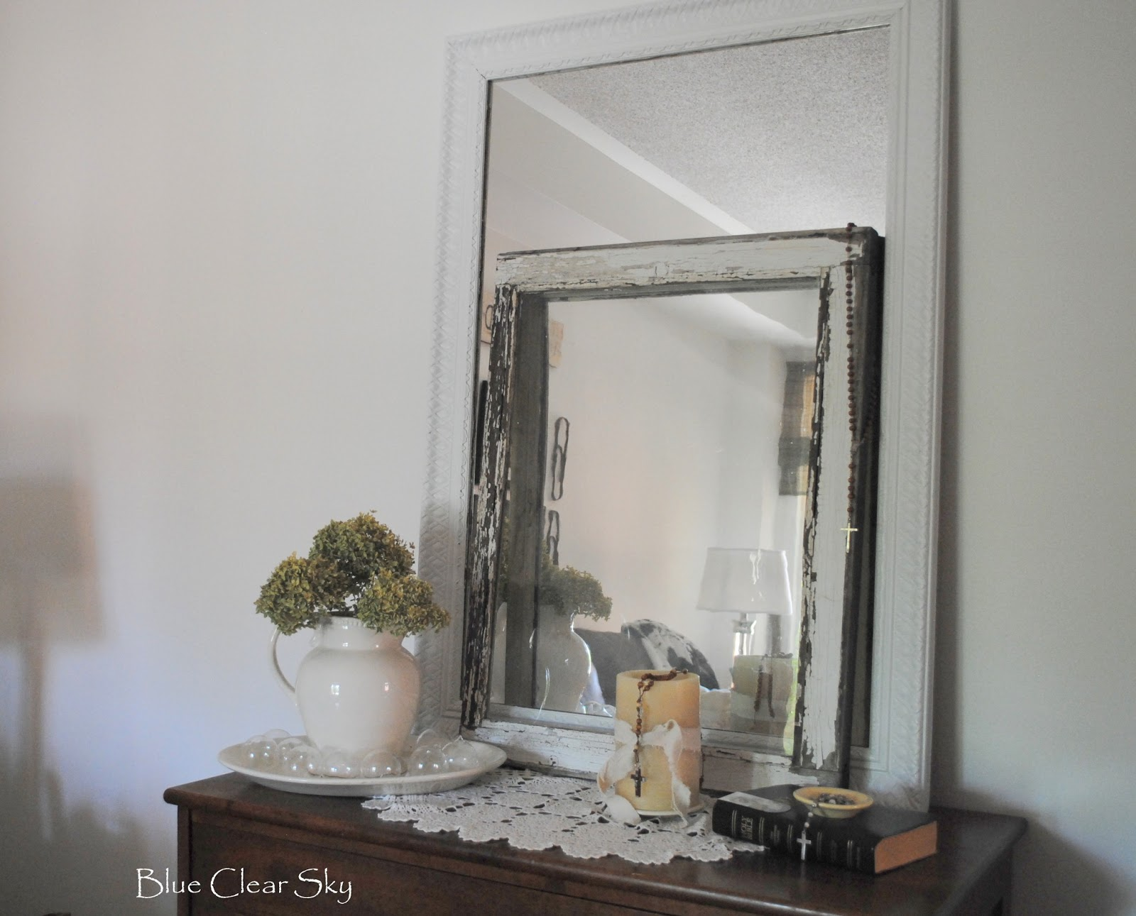 8 gold mirror painted white for our living room