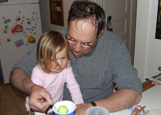 Sierra dyes Easter eggs with Grandpa Bob