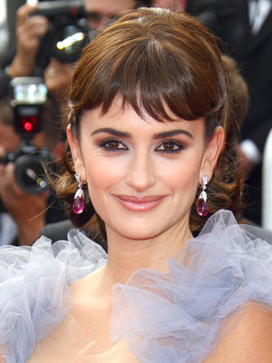 Penelope Cruz looks stunning with short bangs and an elegant updo
