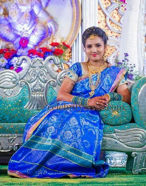 Bride in Sky Blue Floral Saree