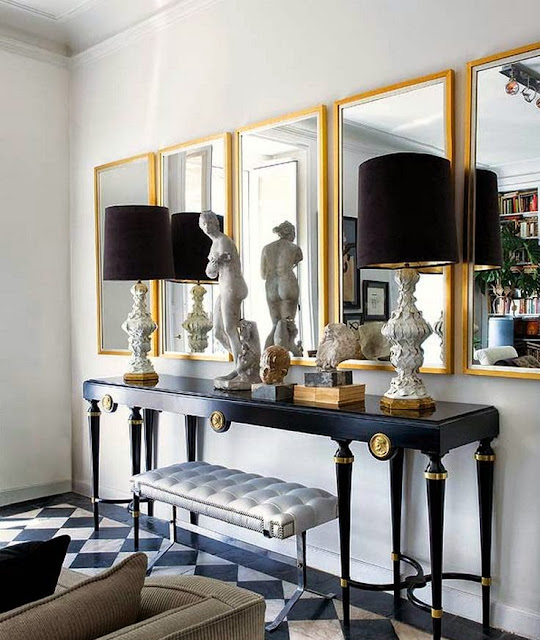 glamorous foyer decorating black console table gold mirrors black lamps tile floor