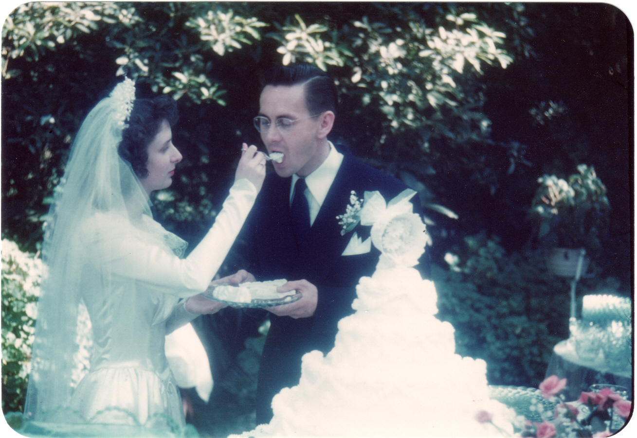 Mom feeds Dad cake at their wedding
