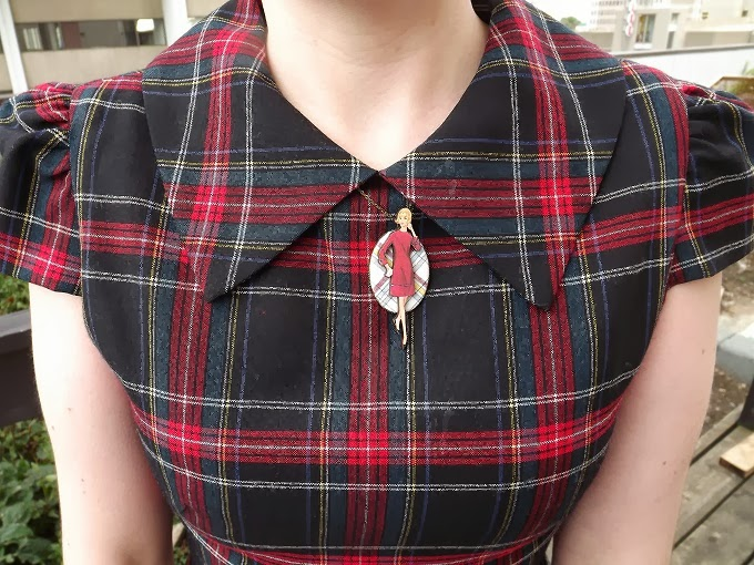Rachel Antonoff, kitty pocket, plaid mini dress, holiday, Christmas, Modcloth, blogger model, Pocket Purr-fect, Mod You Look Necklace, tartan, close up, A Coin For the Well, Suzanne Amlin