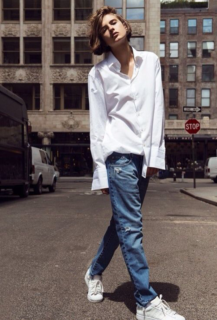 Tomboy style, oversized men's shirt, boyfriend jeans, distressed denim, all white Adidas Superstars, streets of SoHo, NYC