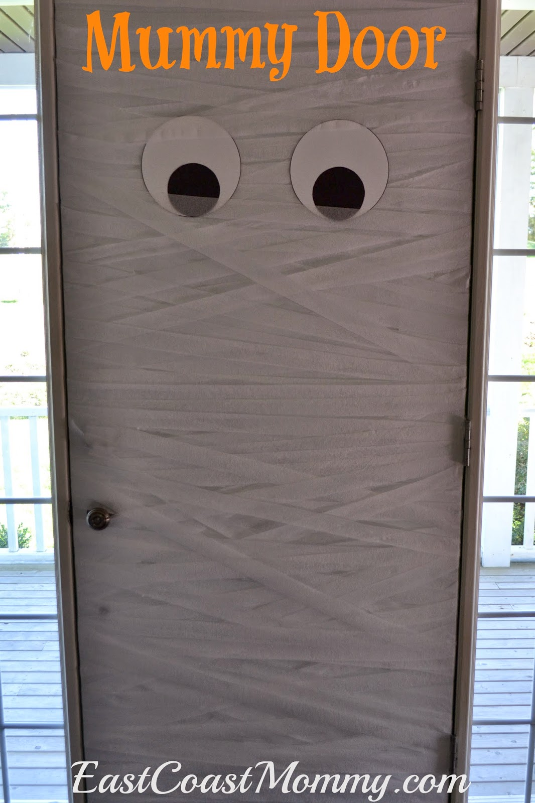 For Christmas we turned our door into a snowman and for Easter we transformed it into a bunny. So... for Halloween we decided to create a Mummy Door! & East Coast Mommy: Mummy Door