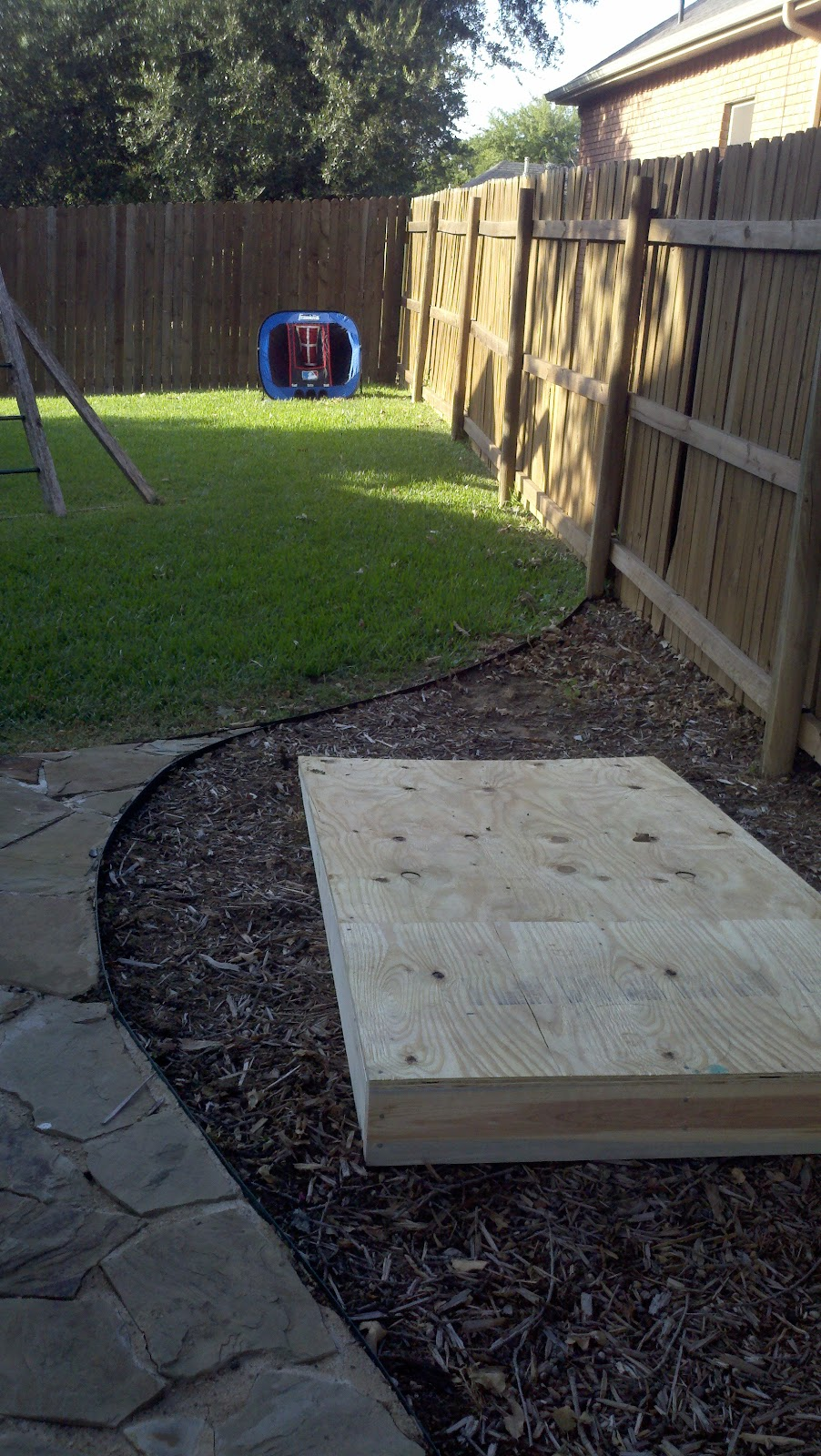 here is the mound in the back yard thomas can practice pitching